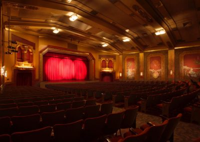 Stage curtains are lit by spotlights in the Paramount Bristol's art deco theater.